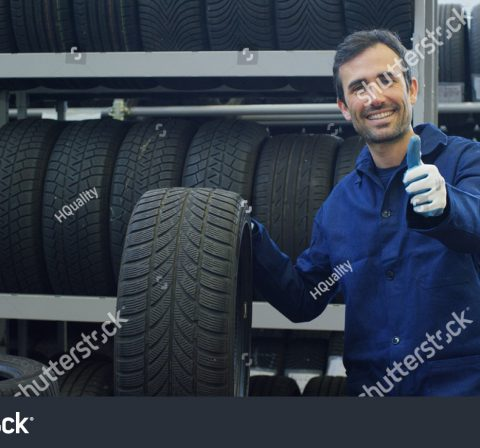 stock-photo-portrait-of-a-young-beautiful-car-mechanic-in-a-car-service-in-the-background-of-rubber-concept-633895742